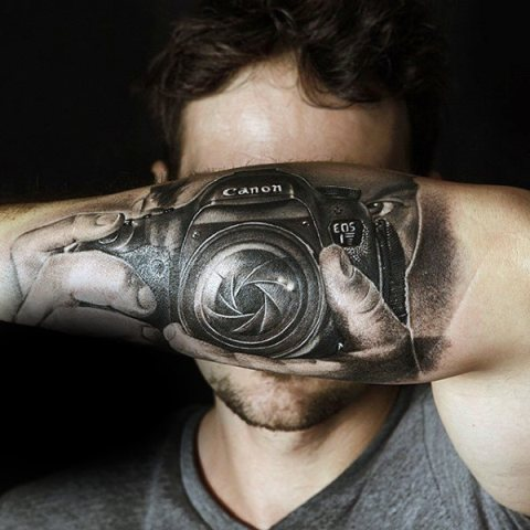 Cool camera tattoo on the forearm