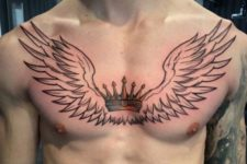 Crown and black-contour wings tattoo