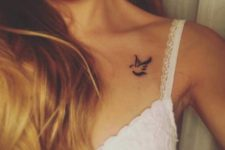 Cute tiny dove tattoo on the collarbone