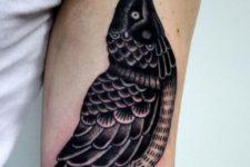 Diamond and bird tattoo on the arm