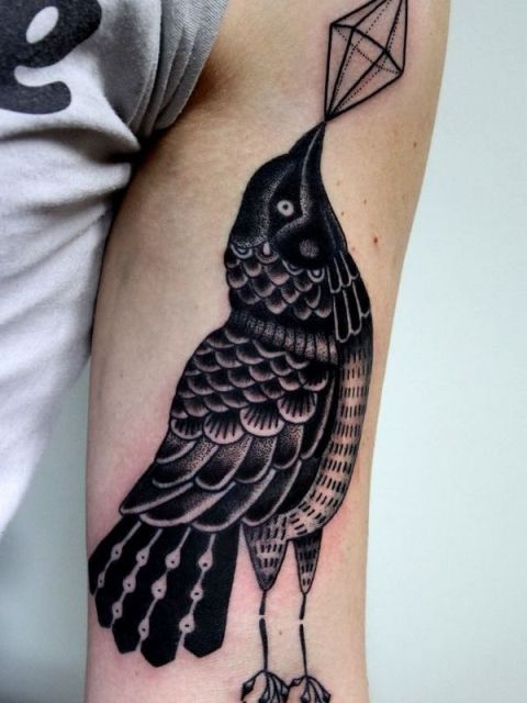 Diamond and bird tattoo on the arm