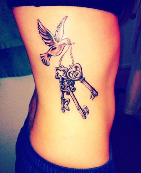 Dove and three keys tattoo on the side