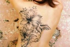 Dove, flowres and skull tattoo on the back