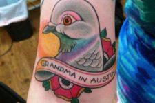 Dove head tattoo on the arm