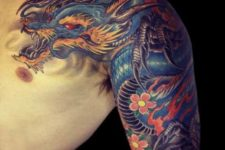 Dragon and flowers tattoo on the hand
