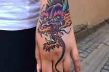 Dragon head tattoo on the hand