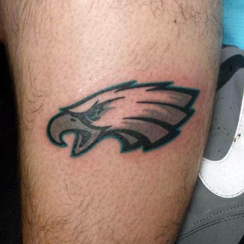 Eagles logo tattoo on the arm