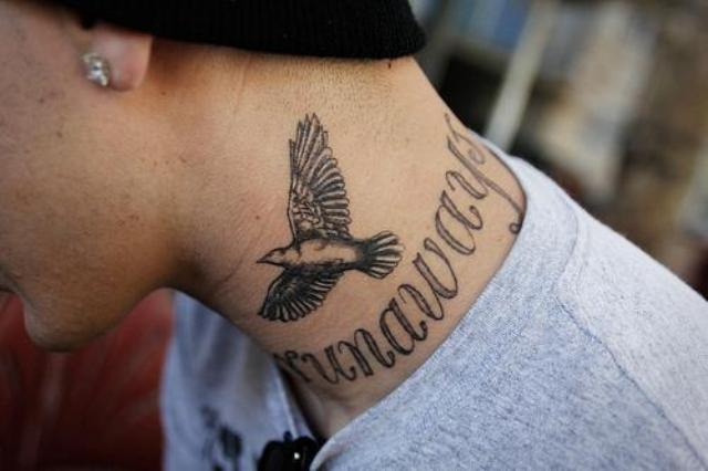 Flying dove tattoo on the neck