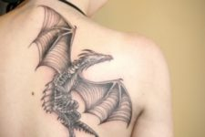 Flying dragon tattoo on the back