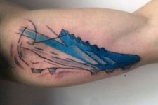 Football boot tattoo on the biceps