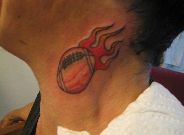 Football with flame tattoo on the neck