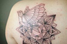Geometric dove tattoo on the shoulder