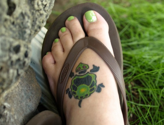 Green turtle tattoo on the foot