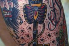 Key and skull tattoo on the leg