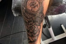 Key, rose and compass tattoo