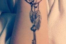 Key tattoo on the forearm