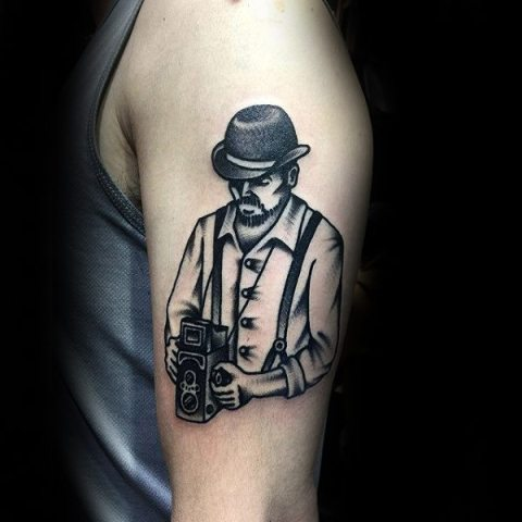 Man with retro camera tattoo on the hand