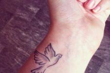 Minimalistic dove tattoo on the wrist