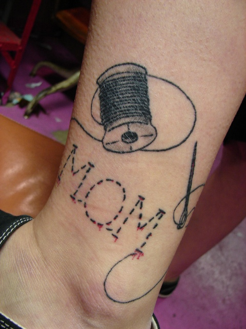 Picture of needle and thread tattoo on the ankle for Sewing needle tattoo