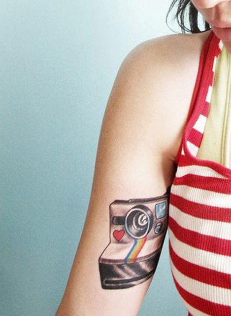 Polaroid camera tattoo on the arm