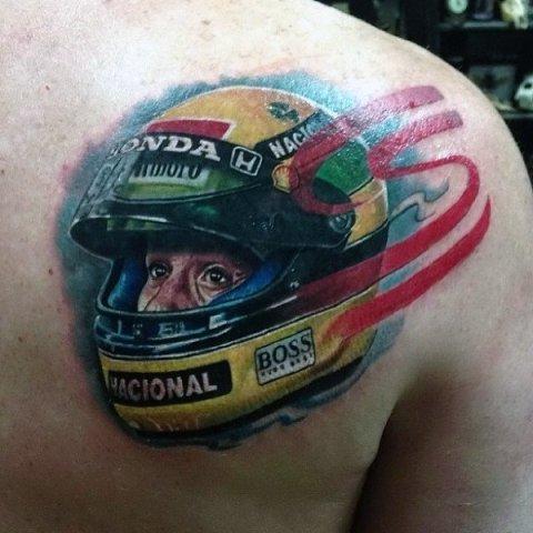 Racing helmet tattoo on the shoulder