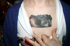 Retro camera tattoo on the chest