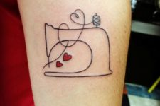 Sewing machine and red hearts tattoo