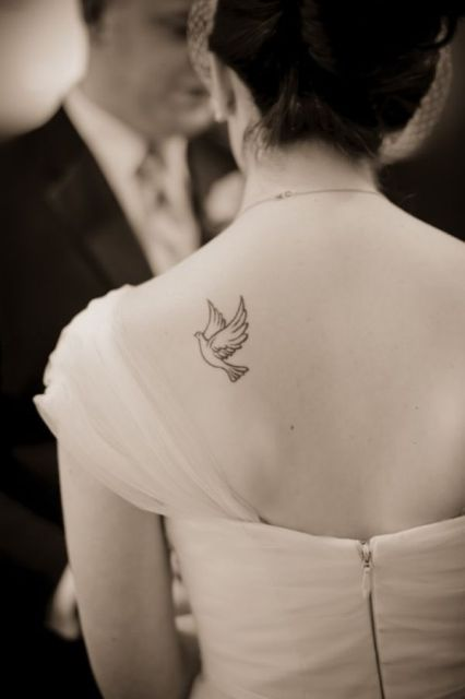 Small dove tattoo on the back