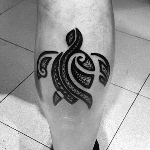 Small tribal turtle tattoo on the leg