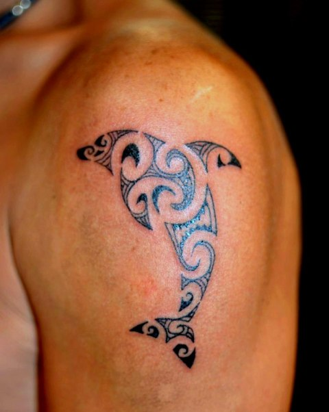 Tribal dolphin tattoo on the shoulder