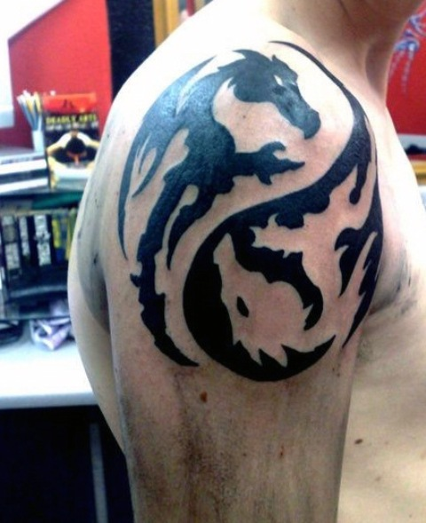 15 Magnificent Leo Tribal Tattoos: Picture Of Tribal Dragon Tattoo Idea On The Shoulder