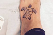 Turtle tattoo with world map image on the foot