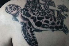 Turtle with castle tattoo on the back