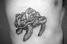 Turtle with gem stones on shell tattoo on the side