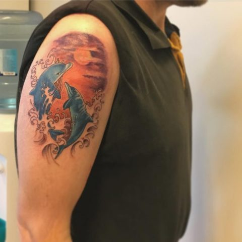 Two dolphins and sunset tattoo