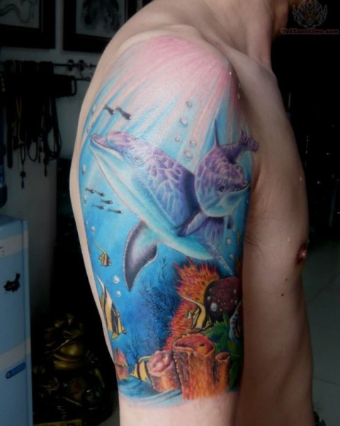 Two dolphins under the sea tattoo