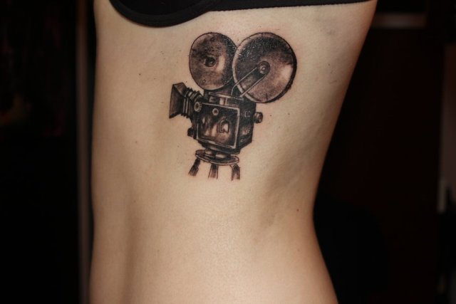 Vintage camera tattoo on the side