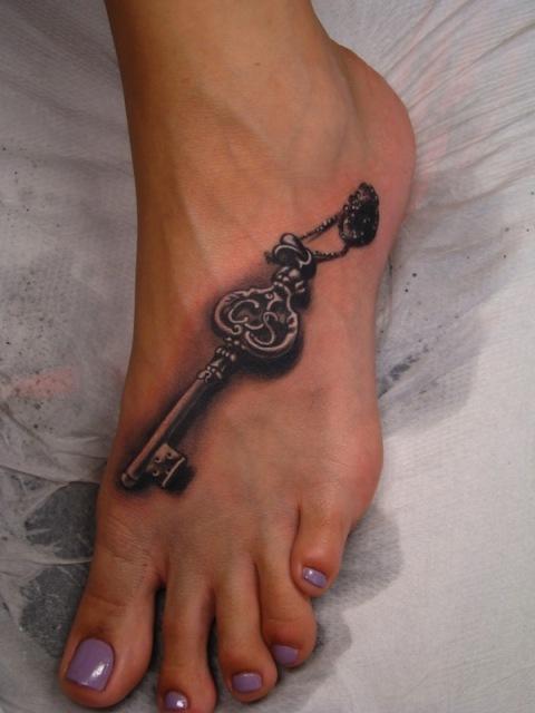 Vintage key tattoo idea on the foot