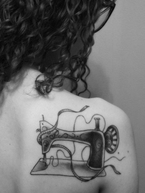 Vintage sewing machine tattoo on the shoulder