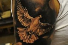 White dove tattoo on the biceps
