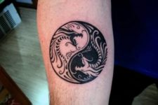 Yin Yang styled dragon tattoo on the hand