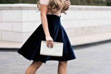 02 a blush t-shirt, a navy high waisted knee skirt and blush ankle strap shoes for a glam look