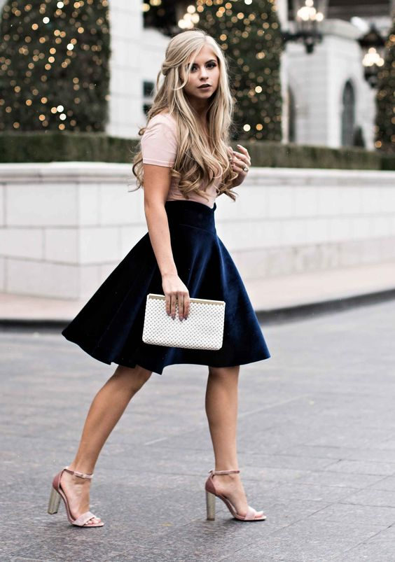 a blush t-shirt, a navy high waisted knee skirt and blush ankle strap shoes for a glam look