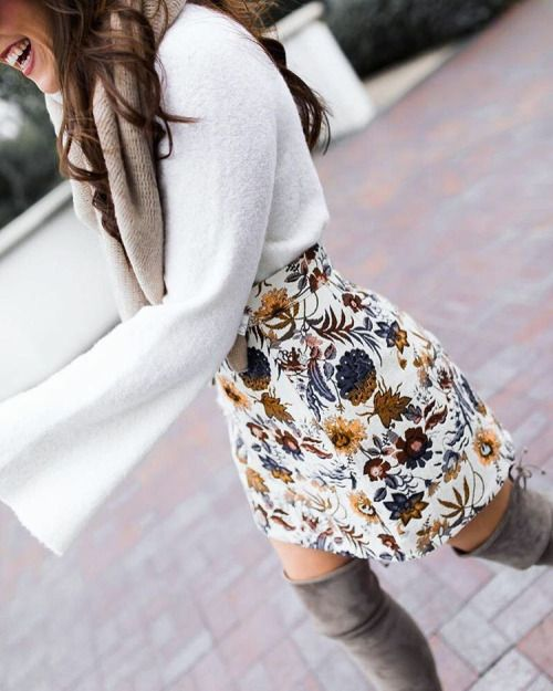 a chic floral mini skirt, a white sweater, a neutral scarf and tall grey suede boots