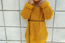 02 a mustard knit dress with a brown belt, cowboy boots and red socks for a boho feel