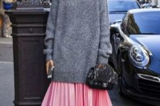 02 a pink pleated midi skirt, an oversized grey sweater, pink velvet shoes with lacing up