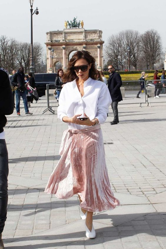 a pink pleated velvet midi skirt, a white shirt and white booties is a chic glam look