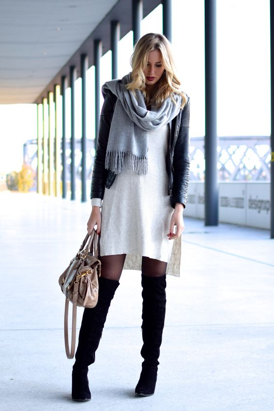 a white sweater dress, black suede boots, a leather jacket and a grey comfy scarf