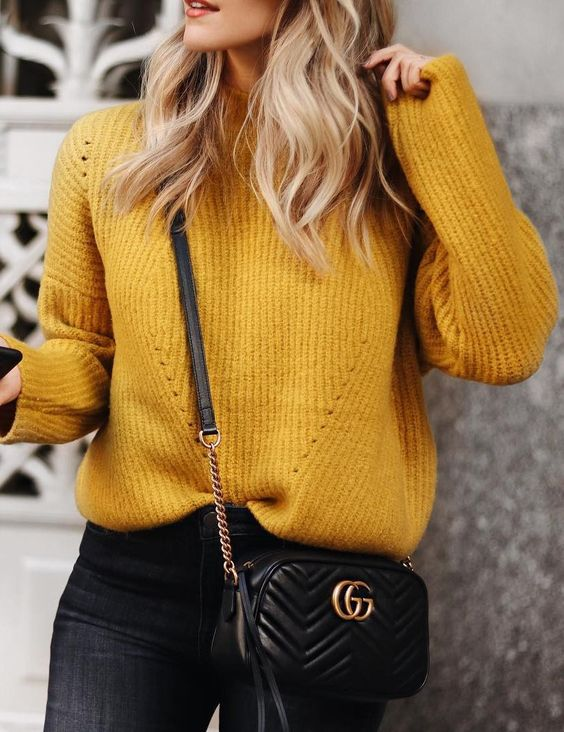 an eye catchy mustard sweater, black jeans and a black cross body bag for a casual look