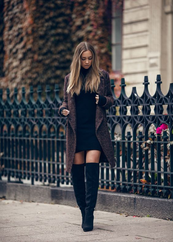 a brown coat, a black sweater dress and black tall boots for a sexy look